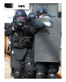 Some dangerous situations require heavy vests, shields and rifles. So explain that.
