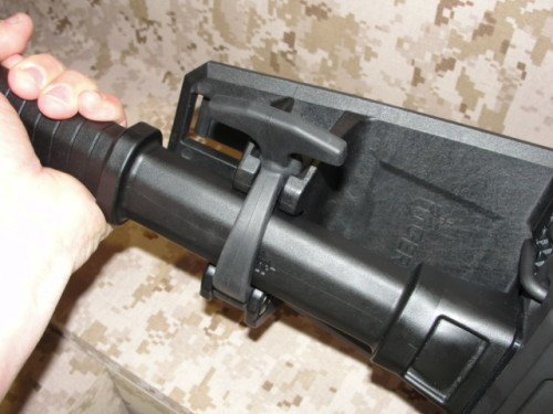 The molded fiberglass handle has pre-set hand stops for sure grip. Note the quick-release rubberized retaining strap.