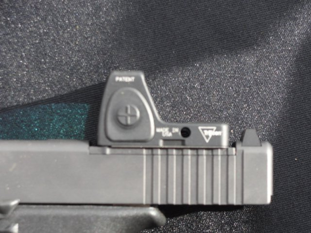 The machined slot is shallow enough not to expose critical internal parts, while still providing a low sight axis for pistol reflex sights.