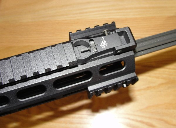 The IRS octagonal hand guard. Here the front sight is folded flush, and (2) small Picatinny attachments have been added.