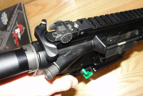 Here the RRA IRS rear sight is folded down flush to the rail.