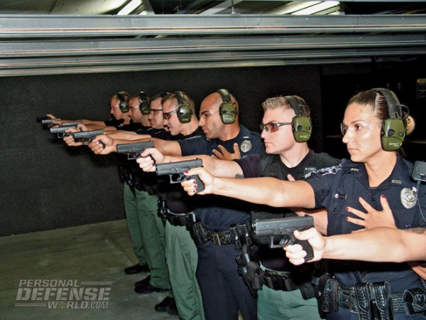 A line of Mariett, GA Police Officers firing their new Glock 42 back-up pistols. (Photo by Personal Defense World).