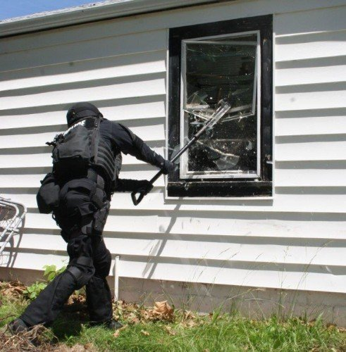 Breaching windows is another specialized skill set of SWAT teams (Author in training).