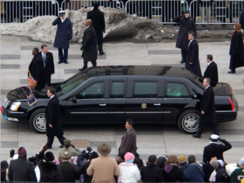 The trench coats are obvious, but there is a SWAT team nearby watching. (photo by US Secret Service)