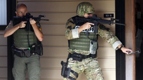 Douglas County Sheriff's Deputies search Umpqua Community College for the shooter (photo by News Review/NR Today)