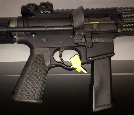 The M5 uses Glock magazines, has a Troy Control Grip, and enlarged trigger guard and magazine release button.