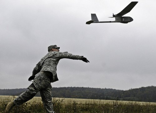 Sgt. Jason E. Gerst, launches the RQ-11B Raven unmanned aerial vehicle (photo on Flickr).