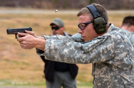 An Army soldier firing a Glock 19 (photo by US Army).