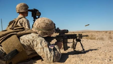 A U.S. Marine fires the M27 IAR HK 416) during training photo by U.S. Marines).