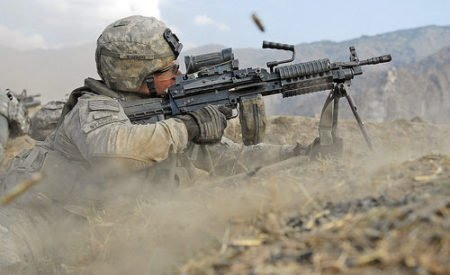 U.S. Soldier fires the M249 SAW at Afghan insurgents (photo by PEO Soldier Live, DoD).