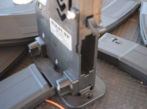 The Mag Pump accepts mil-spec magazines, and releases mags by pressing down on the lever above.