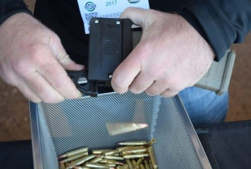 Here the Mag Pump representative is unloading a magazine with the Mag Dump.