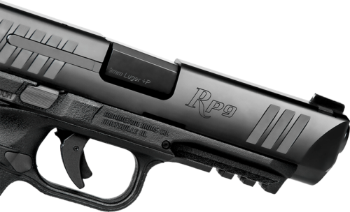 The RP9 has a steel slide with front and rear serrations, and machined labeling.