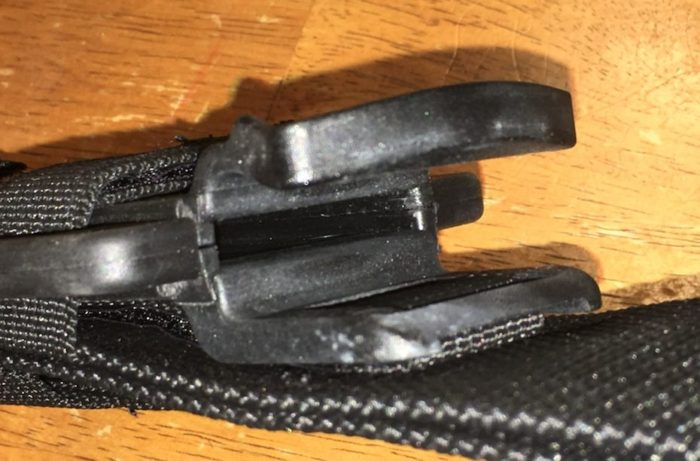The LAPG Infantry Knife rubber-molded sheath has tension lock.