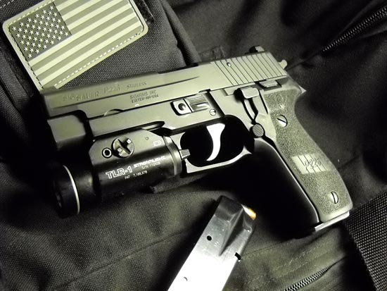 Streamlight TLR-1 weapon light mounted on a SIG SAUER P226