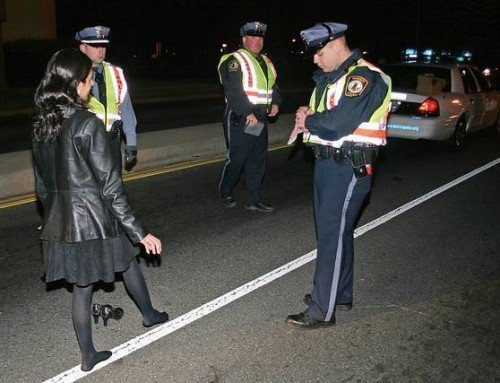 Here the roadway is relatively dry, hard, and level. Notice the woman's high heel shoes have been removed.