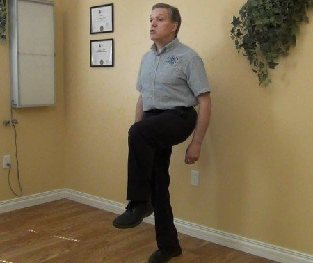 This does not require nearly as much balance as extending the raised leg straight outward (photo from YouTube).