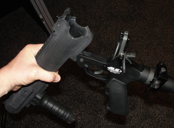 The breech break-open feature is activated by an ambidextrous silver lever just behind and above the trigger group.