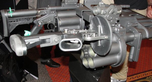 The 6-barrel launcher has a unique break-open system where the receiver actually folds out instead of the cylinder. And yes, that is a dual-mounted 6-cylinder system being developed for military operations.