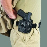 A shooter wearing the Galco Corvus on belt carry.