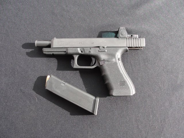 A new Glock MOS pistol. Note the attachment plate sitting in the machined slot at the rear of the slide.