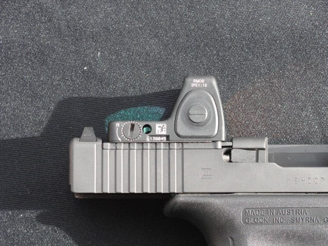 The MOS sight slot does get very close to the extractor, but Glock assures the structural integrity of the slide will remain intact.