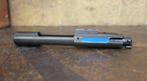 The UTM AR-15 bolt. The French blue marking is clearly visible from the ejection port.