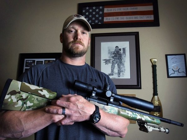 A picture of Chris Kyle holding his GA Precision Gladius rifle.