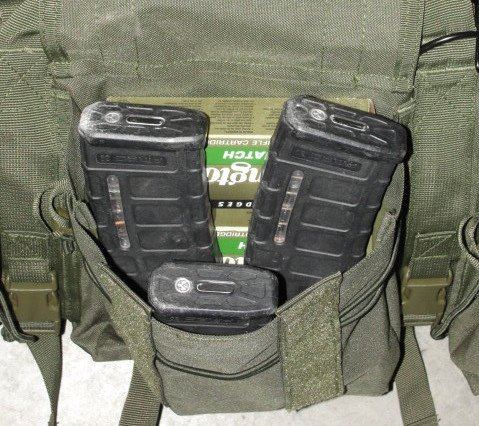 The larger middle pocket can store a lot of loose items. Here (3) Pmags, (2) boxes of AR ammunition, (2) boxes of less lethal shotgun rounds, and several packages of foam ear pro are stored.