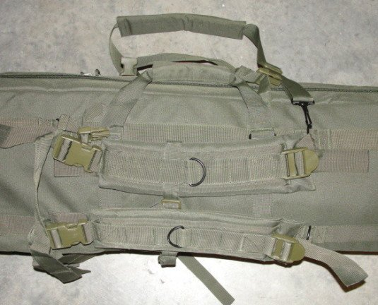 Here the backpack style shoulder straps and one of the carry handles are visible.