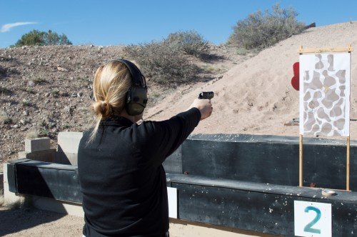 A female shooter putting rounds through the RM380.