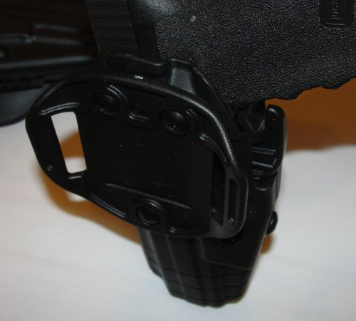 The GLS standard belt loop backing, with a Glock.