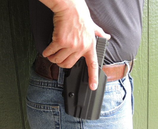 Beginning the withdraw process on the GLS holster.