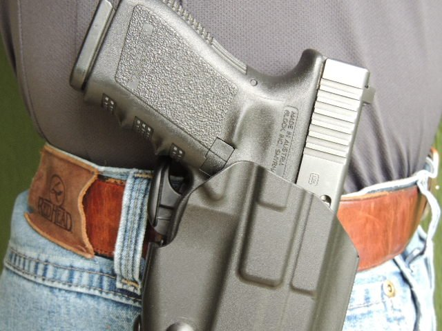 The GLS is positioned to be engaged by the user's middle finger upon proper grip.