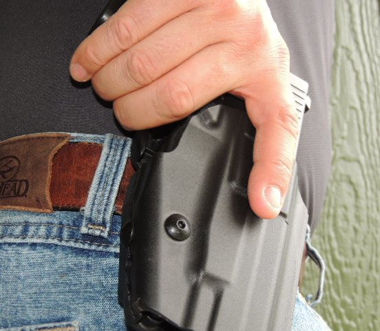 As the shooter begins to grip the pistol, the middle finger intuitively engages the GLS locking lever.