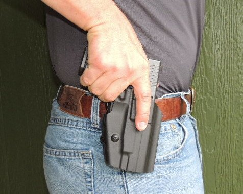 Once the shooter's grip is secure on the pistol, the natural grip disengages the GLS locking lever.