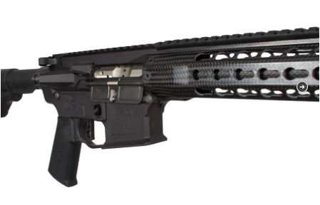 The carbon fiber hand guard overlays the carbon fiber wrapped barrel.