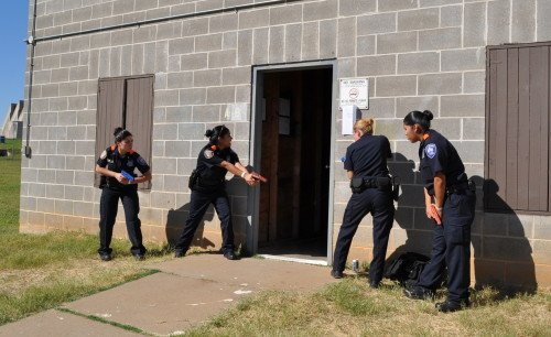 Uniformed SWAT officers making entry as a Sweep Team fulfills legal requirements and safety needs. (photo by sapdexplorers.com)
