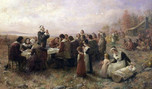 Pilgrims celebrating the first Thanksgiving in 1621 (painting by Jennie Augusta Brownscombe, 1914).