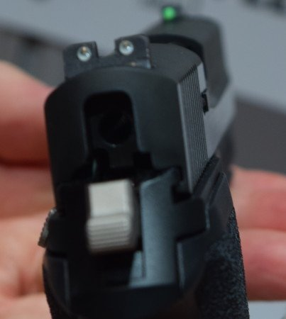 The TRUGLO fiber optic front sight stands in stark contrast to the SIGLITE rear night sights.