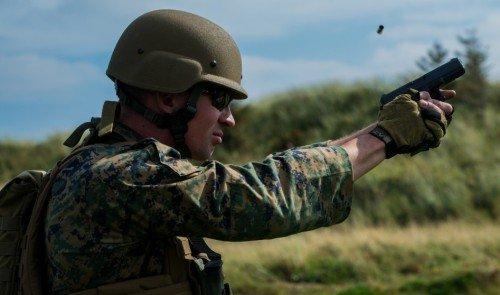 Sgt. Devin Hughes of the Marine Shooting Team firing a Glock 19.