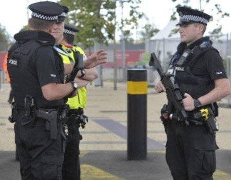 Scottish Police armed with Glock sidearms and HK UMP sub-machine guns.