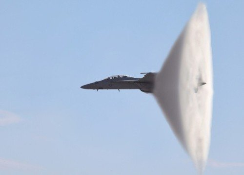 Speed and surprise are fine things, like this F-18 breaking the sound barrier.