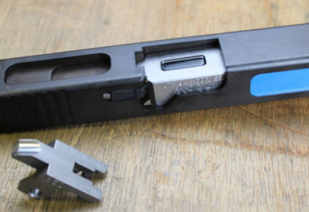 Here a special cut-away Glock barrel shows how the UTM conversion kit fits - note the same bright blue indicator for safety.