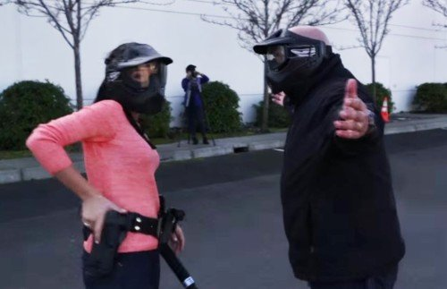 Appropriate force is not always clear, as seen by this civilian in police training grabbing her gun on an armed suspect (photo from YouTube.com)