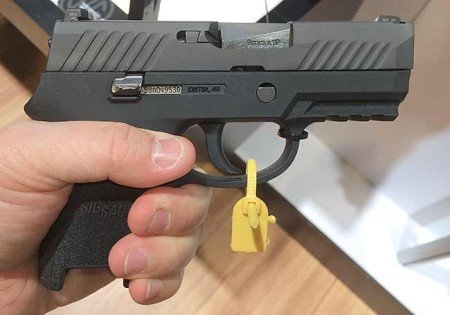 The P320 Compact just fit my hand, where the magazine would sit flush with the grip base (photo from gunsholstersandgear.com).