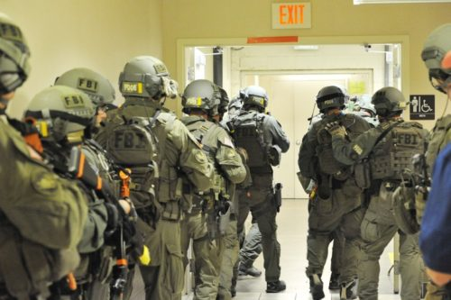An FBI SWAT Team practices Hall Boss procedures for Active Shooters (photo by fbi.gov).