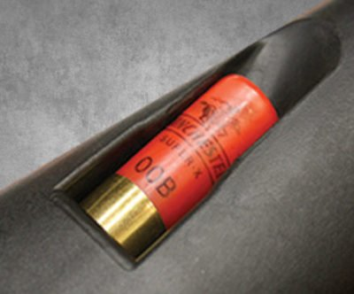 An additional 4-rounds are stored in the spring-activated stock compartment.