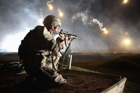 An Army soldier firing the Colt M4 carbine (photo by Army Specialist Venessa Hernandez).