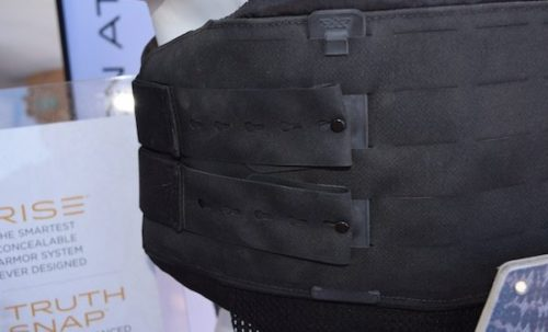 The QuadCore system uses key mod holes and Molle quick attach strap with attachment studs.